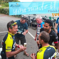 Celebrating completing the Marmot Tours Raid Corsica with a glass of champagne