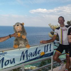 Celebrating on the hotel balcony after completing the Raid Corsica with Marmot Tours