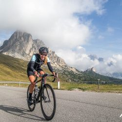 Female rider cycling through the Dolomites on the Marmot Tours Dolomites classics road cycling holiday