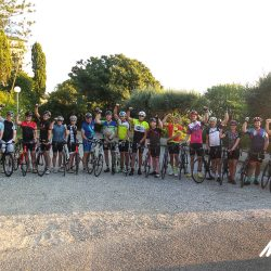 Group of eager cyclists await the start of the Raid Corsica with Marmot Tours