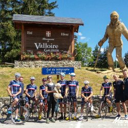 Marmot Tours staff pose for a photo with the French National road racing team in the alps