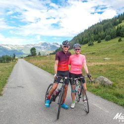 Pausing for a photo on the classic cols of the alps road cycling holiday with Marmot Tours
