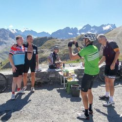 Photo of a photo at the summit of the Galibier on the Marmot Tours classic cols of the alps road cycling holiday