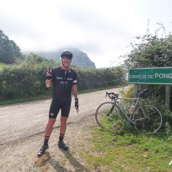 Posing for a photo atop the Ponga on the Marmot Tours road cycling holiday ion the Picos
