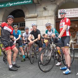 Smiles at the cafe with Marmot Tours in the pyrenees road cycling