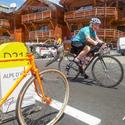 crossing the finishing line at the summit of Alpe d'Huez on the Marmot Tours classic cols of the alps road cycling holiday