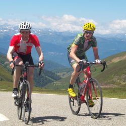 Two cyclists summit the Col de Pailheres on the Marmot Tours Raid Pyrenean