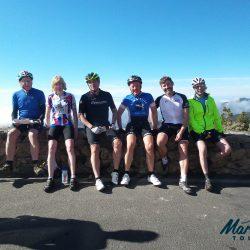 Cyclists Group shot at the summit of Picos de las Nieves, Gran Canaria