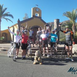 Group cyclists photo in front of rural church in Gran Canaria