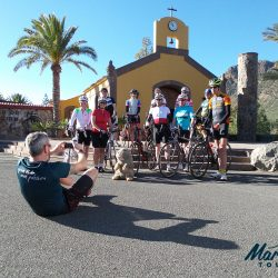 Marmot Tours Guide catching a group photo of cyclists in Gran Canaria