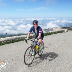 Smiling at the summit of Ventoux with Marmot Tours