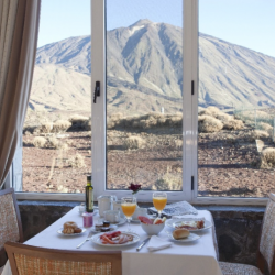 Breakfast in Parador de Canadas del Teide view a of Pico del Teide