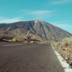 Cyclist on the TF21 with Mt Teide in the background during a Marmot Tours cycling holiday in Tenerife.