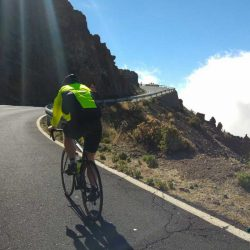 Cyclist going uphill on the TF21in Tenerife.