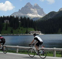 Cycling by Lake Misurina in the Dolomites mountains