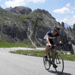 Happy cyclist on quiet roads in the Dolomites Italian mountain range