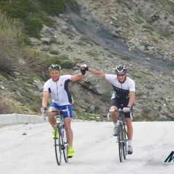 Two Marmot Tours cyclists achieving a challenge together on the Raid Sardinia