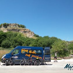 Supporting Cyclists on the Raid Sardinia under blue skies