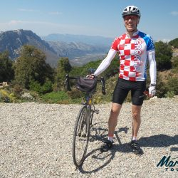 Cyclist on Genna Silana Pass Sardinia Italy on a Marmot Tours cycling holiday