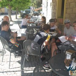 Relaxing in cafe during a Cycling Holiday in Sardinia, Italy, Europe. Marmot Tours