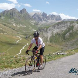 Cyclist near the top of the Croix de Mer / Glandon road junction. Photo by James Thompson (Marmot Tours road cycling holidays)