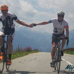 Two Marmot Tours clients near the top of the Col de Madelaine during a road cycling holiday in the Northern Alps