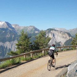 Cyclist on the balcony road near the Pas de Confession in the Oisans valley, near L'Alpe D'Huez - Photo by James Thompson (Marmot Cycling Holidays)