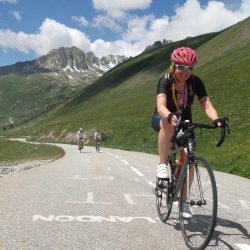 Woman cyclist on the Croix de Fer / Glandon road climb during a Marmot Tours road cycling holiday