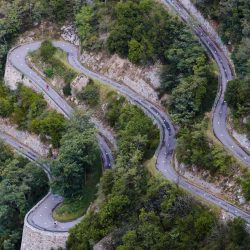 Lacets de Montvernier in the Maurienne valley. Cyclist s taking part in a Marmot Tours road cycling holiday.