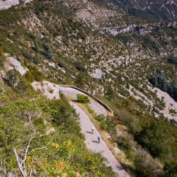 Two Marmot Tours riders descend into the spectacular Cirque de Navacelles on day 5 of the Raid Massif Central - rmc