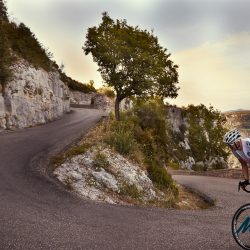 Marmot Tours rider Ian rounds the final hairpin of the majestic Cirque de Navacelles on the Raid Massif Central - rmc