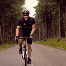 Loyal marmot Tours rider gary, enjoying the quiet forested roads of day 4 of the Raid Massif Central - rmc