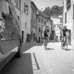 Cycling through village at base of Turini