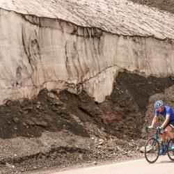 Cyclist passes snow drift on Cime loop