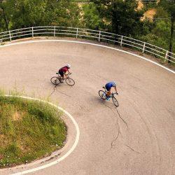 Cyclists climbing Col Lombardia