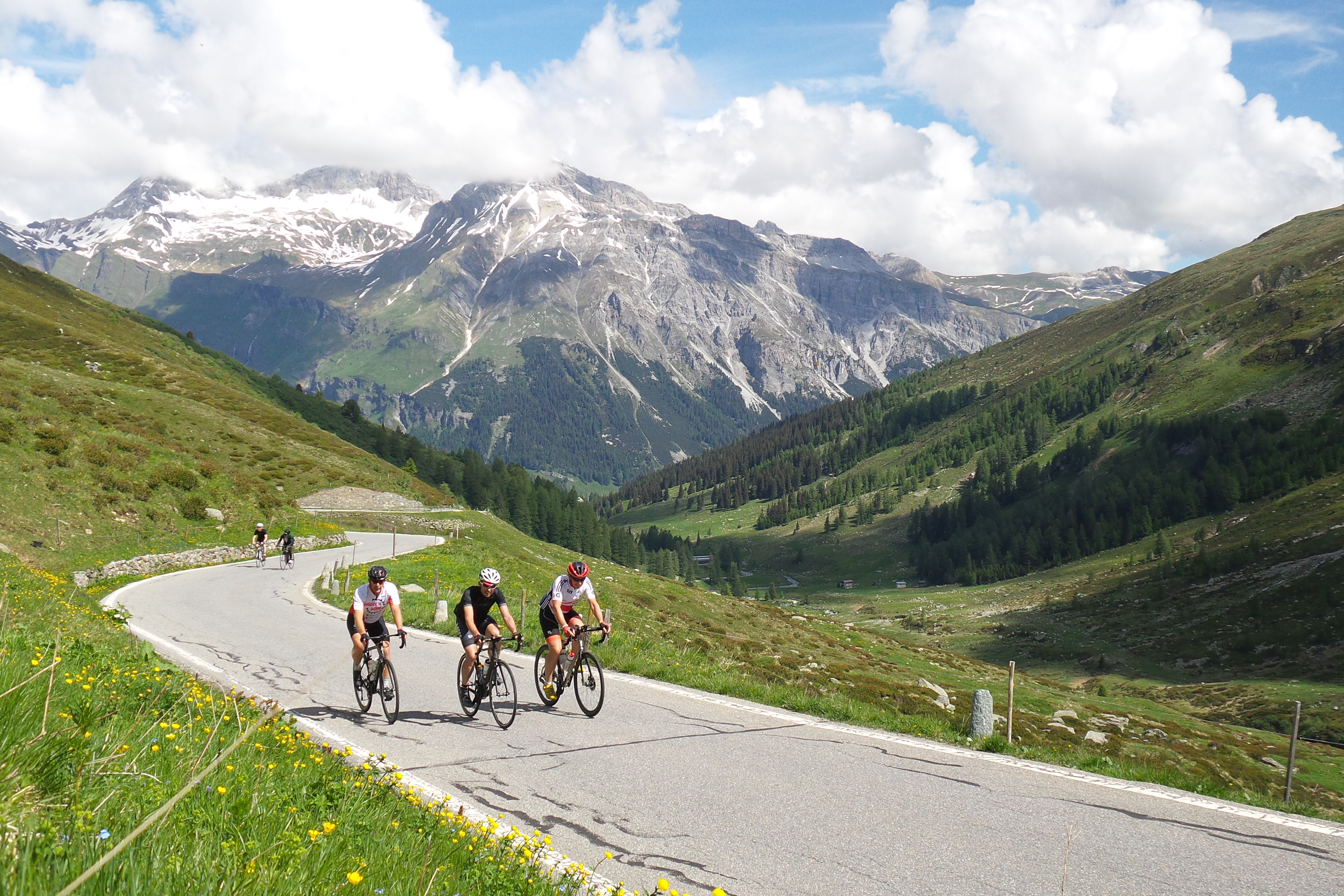 Trio of cyclists ride through the French Alps on the Marmot Tours Classic Cols of the Alps road cycling holiday