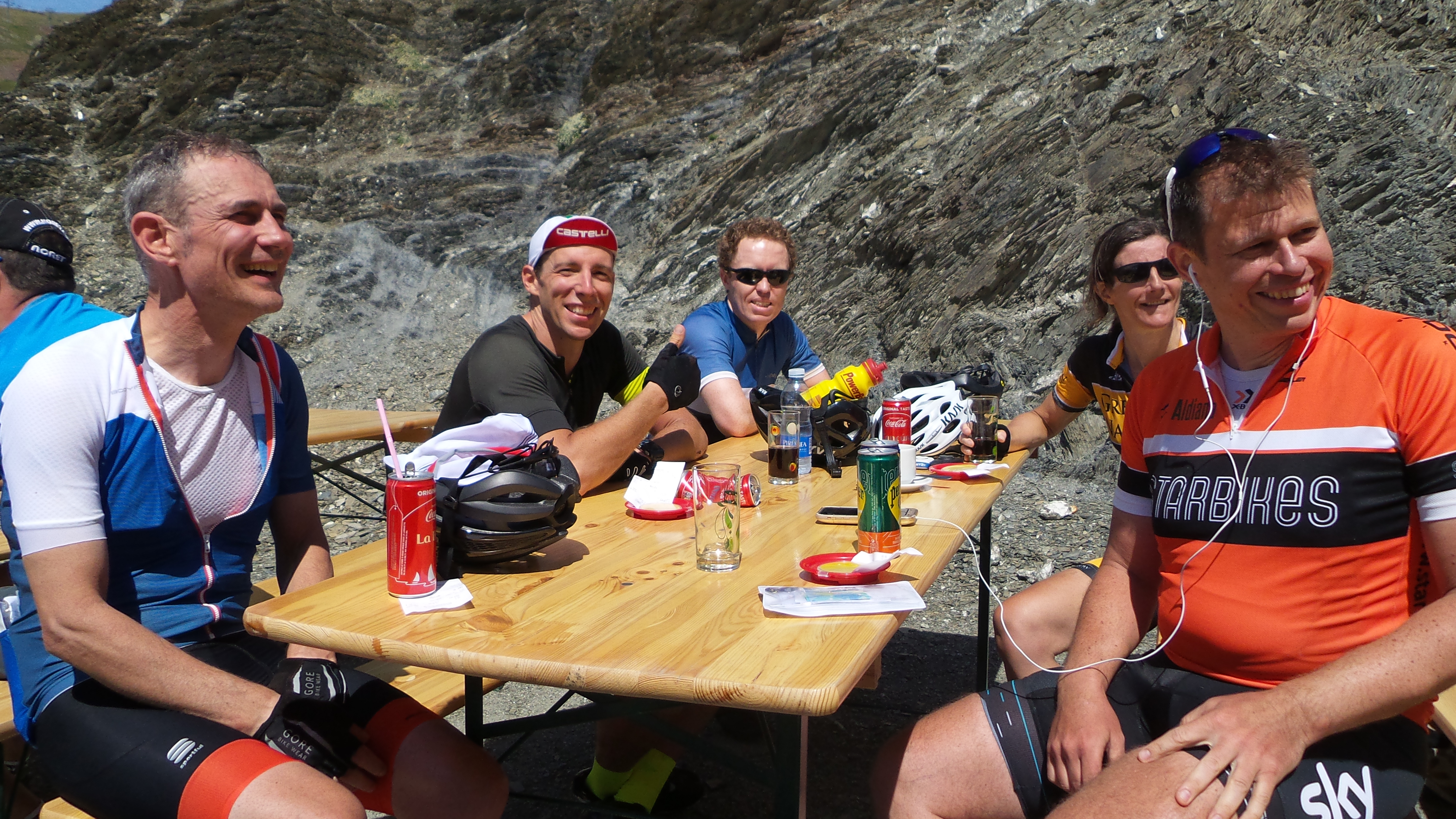 A group of riders relax at a cafe in the Picos on a Marmot Tours road cycling holiday.
