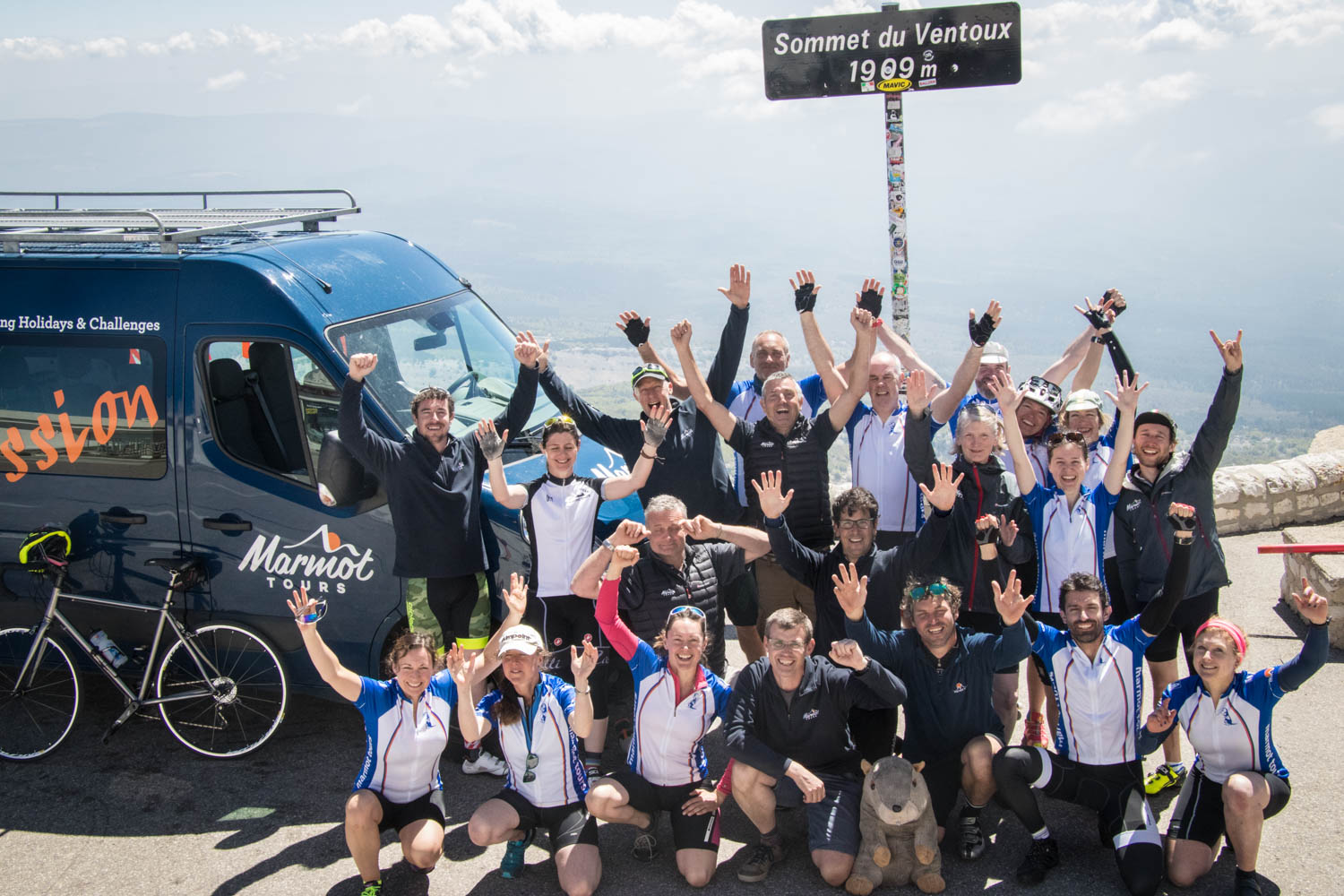 The full Marmot Tours team celebrate atop the mighty Mont Ventoux in Provence