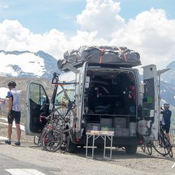 Making use of the support vehicles on the Marmot Tours raid alpine in France.