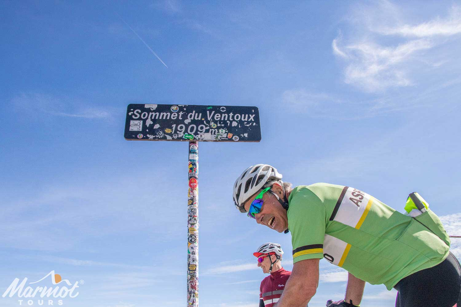 Cyclist celebrating at summit of Mont Ventoux with Marmot Tours road cycling holidays