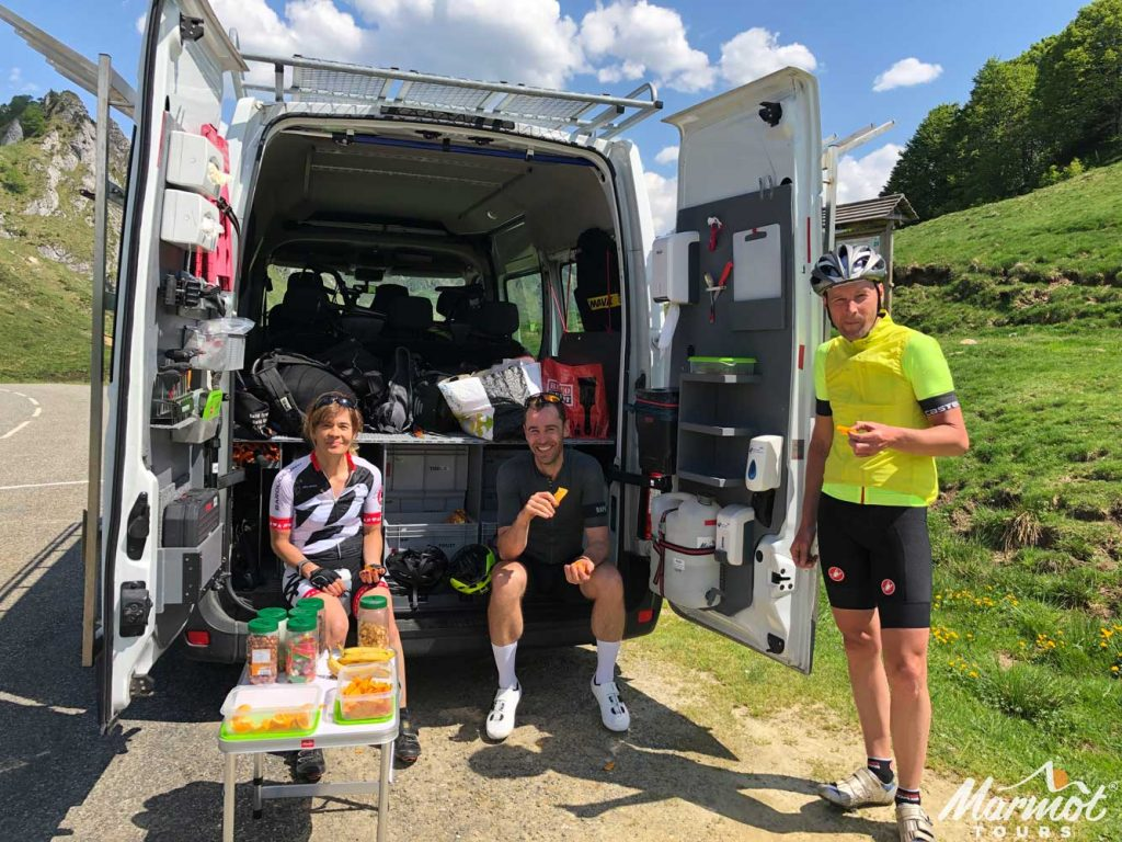 Cyclists having a snack from Marmot Tours support van on fully supported European road cycling holiday with Marmot Tours