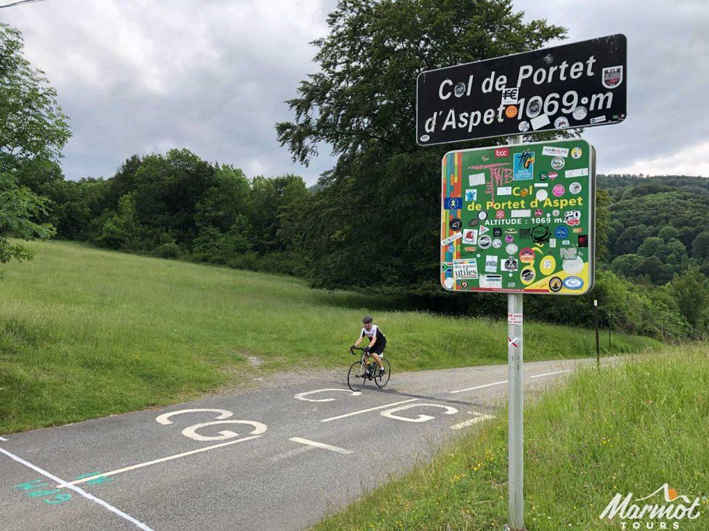 Cyclist on Col de Portet d'Aspet Raid Pyrenean cycling challenge Marmot Tours