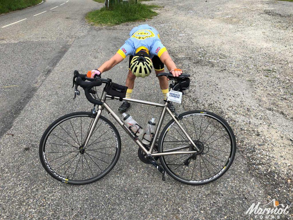 Cyclist stretching Raid Pyrenean cycling challenge Marmot Tours