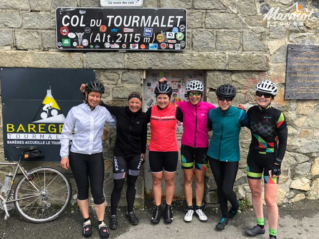 Group of female cyclists on Col Du Tourmalet Raid Pyrenean cycling challenge Marmot Tours