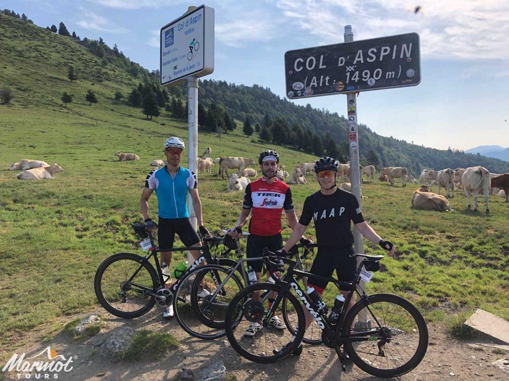 Three cyclists at Col D'Aspin Raid Pyrenees cycling challenge Marmot Tours