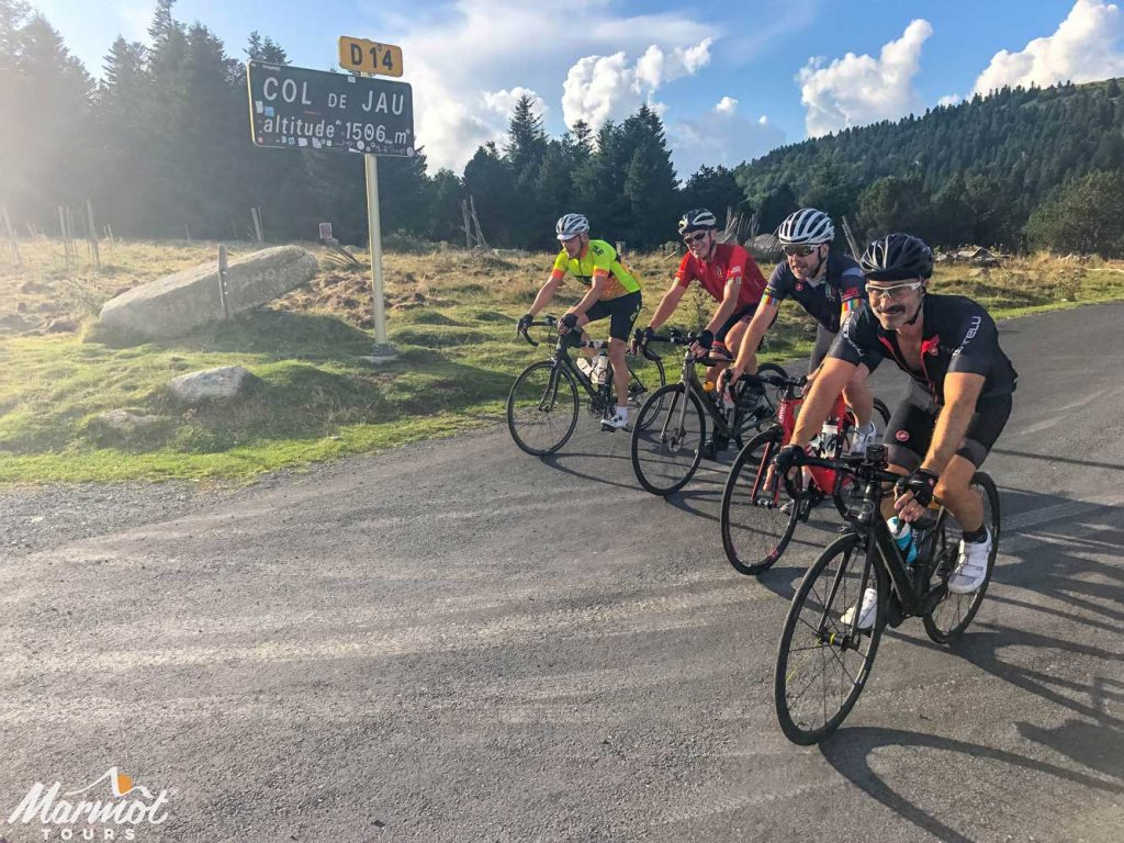 Four cyclists on Col de Jau Raid Pyrenean cycling challenge Marmot Tours