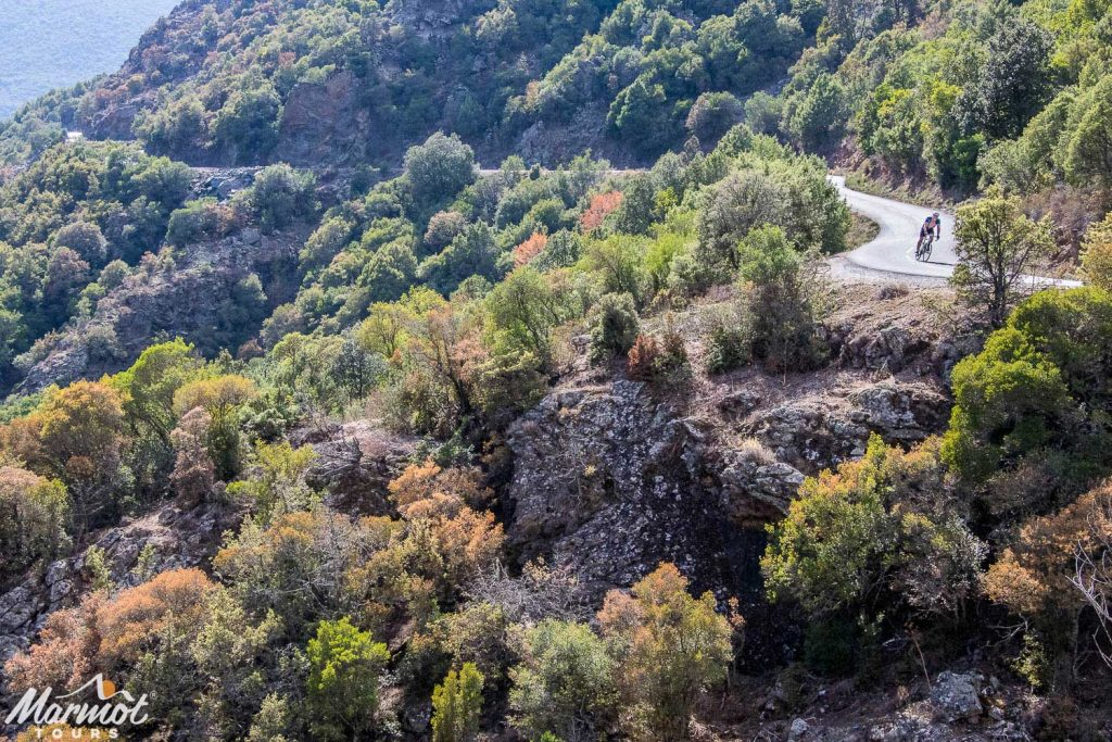 Cyclist heading towards St Florent from Ponte Lecchia on the Classic Cols of Corsica road cycling holiday with Marmot Tours