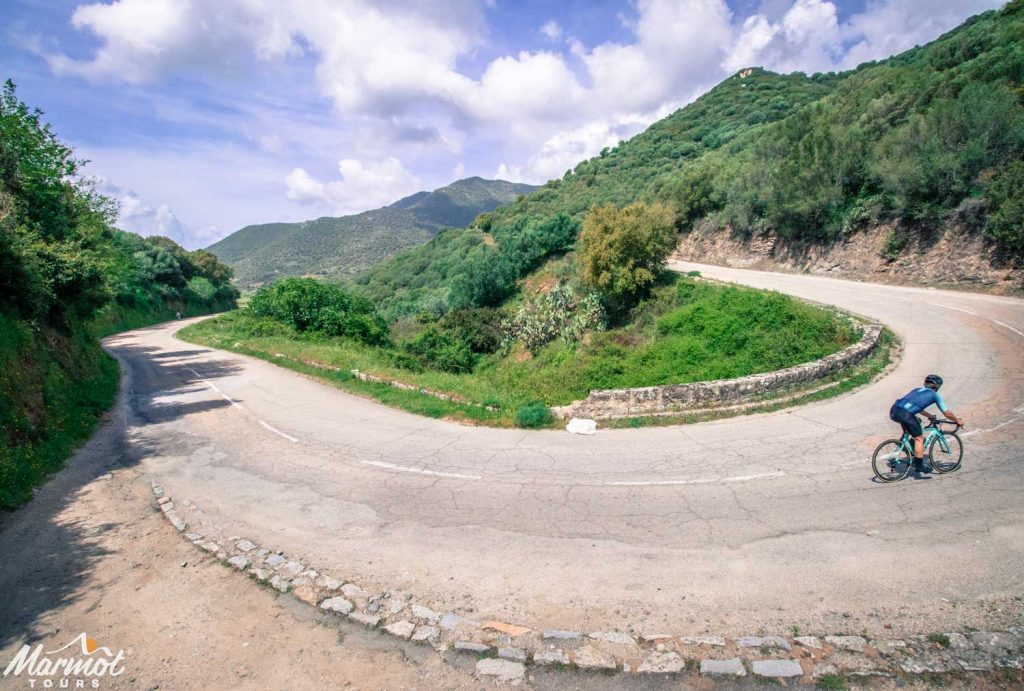 Cycling hairpin bend on guided road cycling holiday in Corsica with Marmot Tours