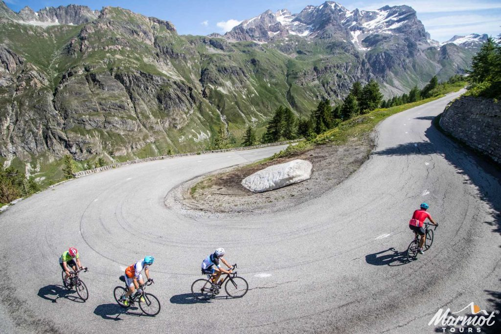 Cyclists enjoying switchback with Marmot Tours French Alps road cycling holiday