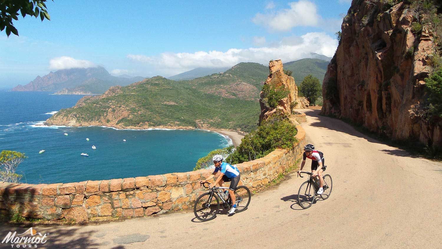 Cyclists on beautiful coastal road with Marmot Tours road cycling holiday in Corsica